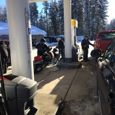 Snowmobiles gassing up in Roslyn