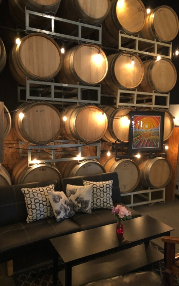 Cozy up to a few wine barrels