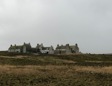 Watching out over Skara Brae, the stalwart Skaill House