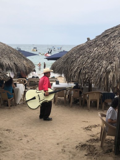 I found the owner! Major props to this guy for schlepping that bass around the beach in long sleeves and pants. That's one hot gig!
