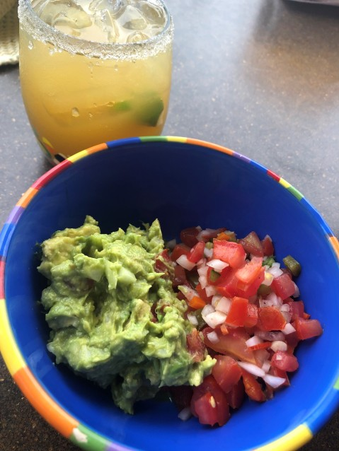 Tamarind margaritas with fresh pico and guacamole. Made by hand with the ingredients we picked up at the market.
