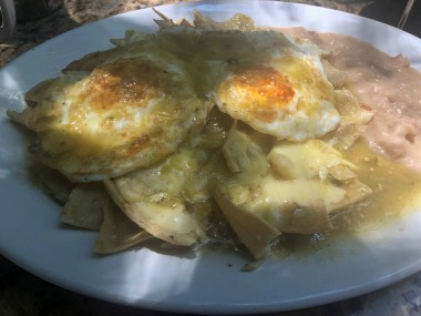 Amazing chilaquiles in the dappled sunlight of the Pancake House