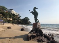 The iconic seahorse statue at the end of the beach