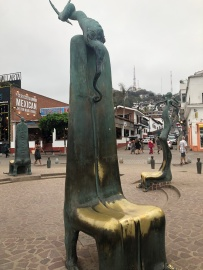 That's quite a chair! Amazing art up and down the Malecon.