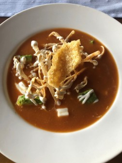 Delicious tortilla soup with fresh chicharrones