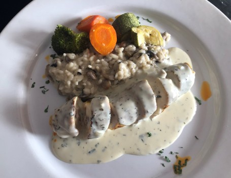Chicken breast stuffed with provolone, artichoke and sun-dried tomato - with mushroom risotto and a tarragon cream sauce. Yum!