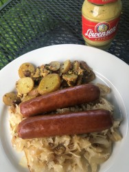 Smoked brats over sautéed onions and sauerkraut w/re-purposed German potato salad from The Bine.